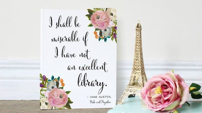 A greeting card and eiffel tower toy, rose flower on table