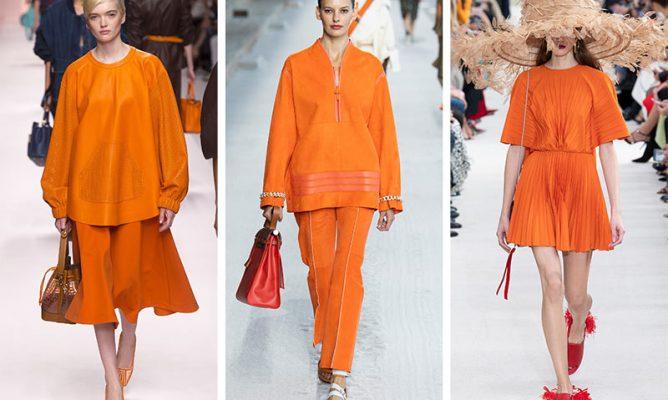 girls wearing a orange dresses and walking on ramp